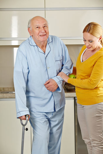 Nurse helping senior patient