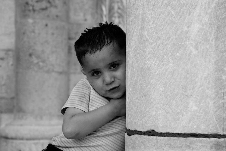 A Syrian child. He is so shy :) Shades Of Grey Streetphotography Streetphoto_bw Blackandwhite EyeEm Best Shots - Black + White Children's Portraits Children Sony Monochrome