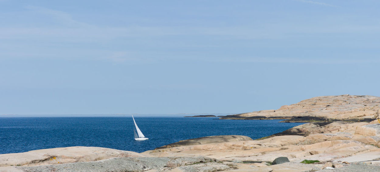 Small sailboat near the shore Sea Water Sky Scenics - Nature Beauty In Nature Day Land Tranquility Nature Horizon Blue Non-urban Scene Rock Nautical Vessel Sailboat Rocky Coastline Idyllic Bohuslän Skagerak Leisure Activity Recreational Pursuit Summer Nordic Sport EyeEmNewHere This Is Strength
