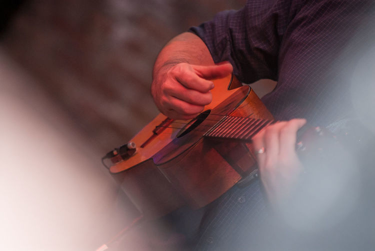 Close-up of man playing ukulele