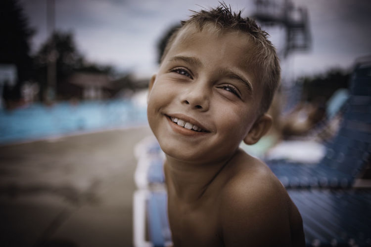 Portrait of cute boy at poolside