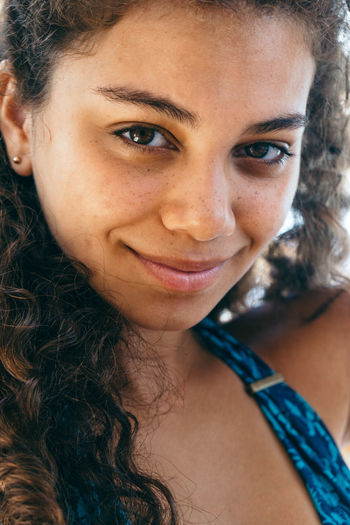 Close-Up Portrait Of Smiling Young Woman