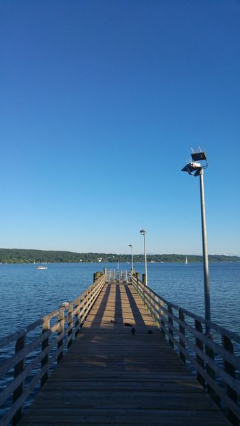 Pier Wood - Material Blue Clear Sky Sea Water Jetty Day Outdoors Sky No People Bird Horizon Over Water Wood Paneling