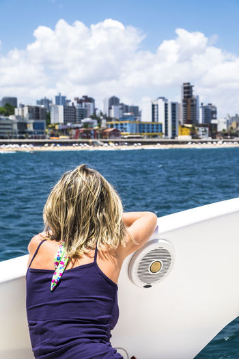 Rear view of woman on boat on sea