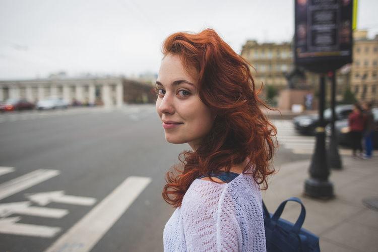 Portrait of woman standing on city street