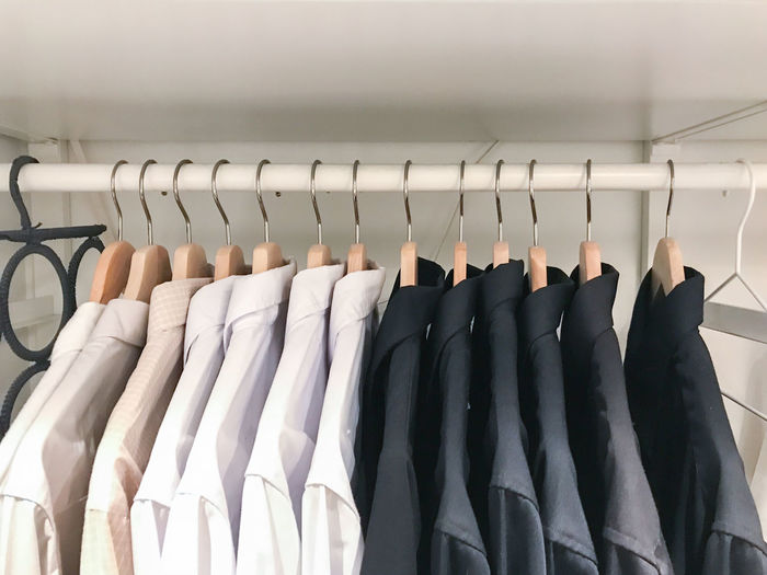 Long Sleeve Shirt. Men's wear department on a railing in a gentlemen's shop. Black Color Button Down Shirt Choice Close-up Clothing Coathanger Day Fashion Hanging In A Row Indoors  Large Group Of Objects Menswear No People Rack Retail  Textile Variation White Color