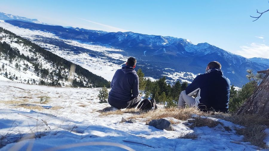 Snow Winter Warm Clothing Sunlight Cold Temperature Mountain Togetherness Landscape Nature Men Outdoors Adventure Hikingadventures Freedom Positive Hiking EyEmNewHere Awesome_shots Freshness View From Above Calmness Peace And Quiet The Great Outdoors - 2017 EyeEm Awards