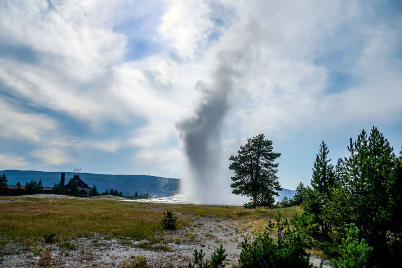 Things to see throughout Yellowstone National Park like the Old Faithful Geyser, blue holes, mountains and lakes it's truly spectacular. Scenic Sky And Clouds Steam Travel View Wyoming Yellowstone National Park Beauty In Nature Blue Holes Clouds Day Fields Flowers Geysers Hot Water Lakes  Landscape Mountains Nature No People Old Faithful Geyser Outdoors Scenics Sky Water