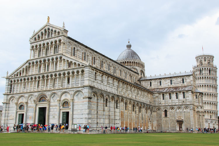 People at cathedral by leaning tower of pisa