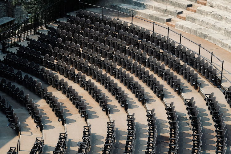 High Angle View Of Auditorium Chairs