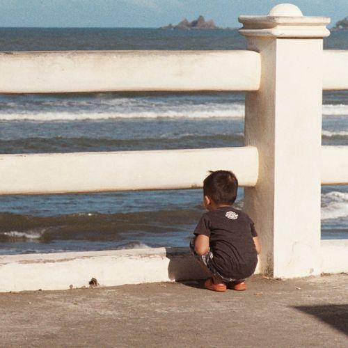 Full length of man sitting at beach