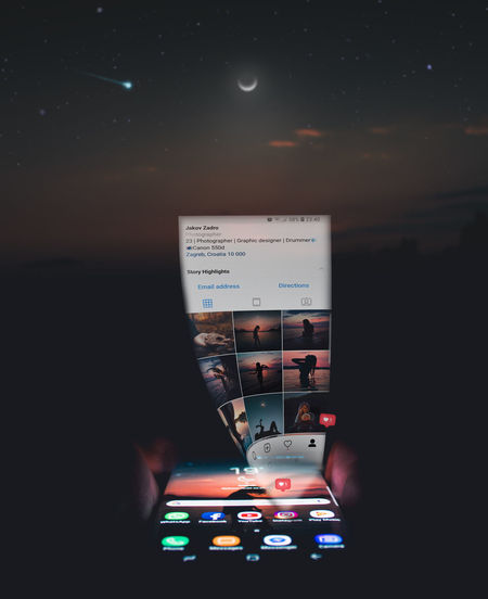 Hologram on mobile phone Falling Star Hologram Moon Photomanipulation Samsung Tumblr Control Panel Faded Hand Holding Human Hand Illuminated Instagram Motion One Person Samsung Edge 7 Samsung S8 Stars Technology EyeEmNewHere