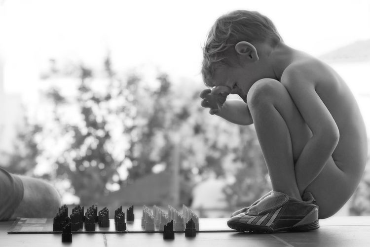 Close-up of boy with chess