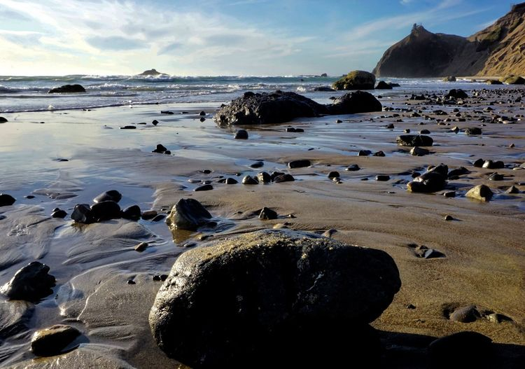 Sea Beach Water Land Sky Scenics - Nature Beauty In Nature Nature Rock Sand Tranquil Scene Rock - Object Outdoors Pebble Tranquility