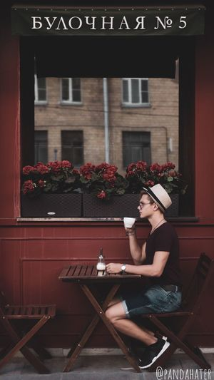 Woman sitting on table by building
