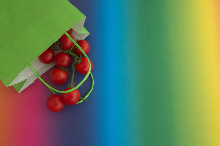 Food And Drink Food Red Healthy Eating Tomato Indoors  Green Color Vegetable Freshness Still Life Blue No People Close-up Colored Background High Angle View Copy Space Directly Above Ripe Bag Paper Paper Bag Rainbow Colors