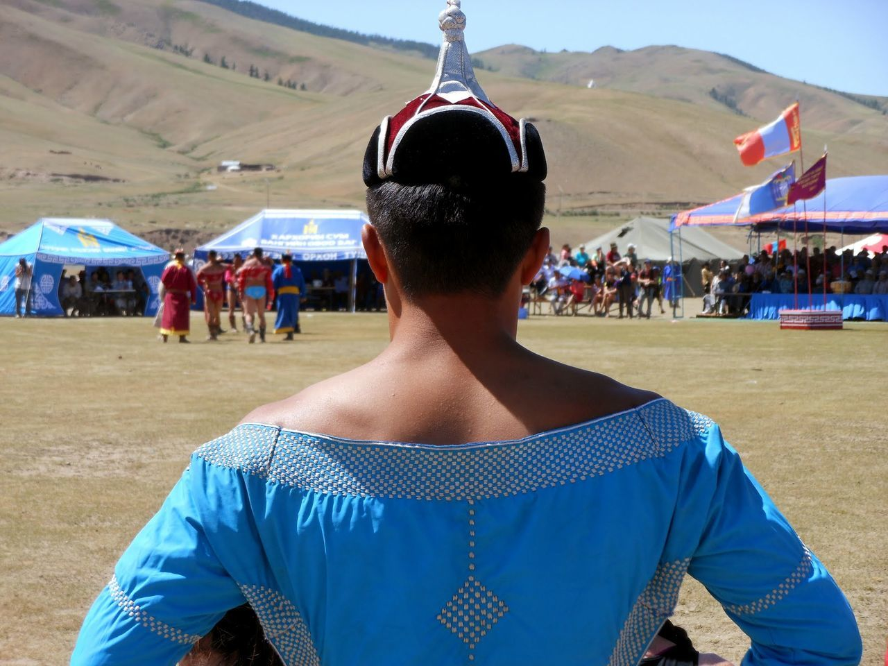 Rear View Of Man Wearing Traditional Clothing While Standing Against Mountain