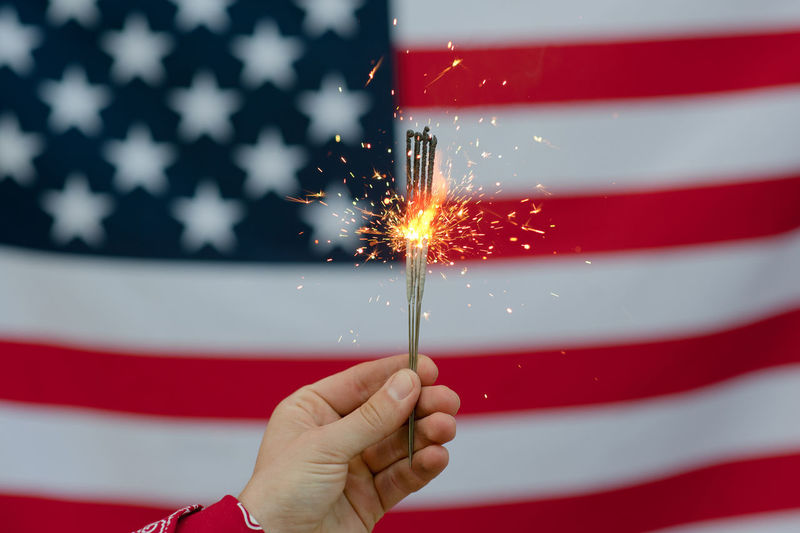 USA flag Flag Patriotism Human Hand Red Holding Celebration Human Body Part Hand Sparkler People Star Shape Shape Burning Sparks Firework Firework - Man Made Object Firework Display