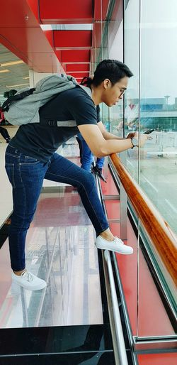 waiting for flight Airportphotography Viewing Bagback Full Length Side View Window Sill Transparent Glass - Material EyeEmNewHere