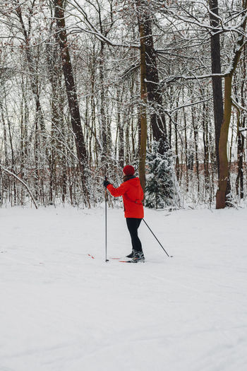 Full length of person skiing on snow covered field