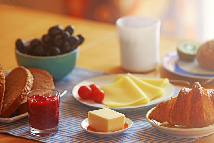 enjoy breakfast on a sunny morning Bright Morning Sunlight Back Lit Breakfast Cheese Close-up Coffee Cup Croissant Enjoyment Food Food And Drink Freshness Fruits Grapes Healthy Eating Indoors  Lifestyles Marmalade No People Plate Ready-to-eat Table Variation Wholegrain