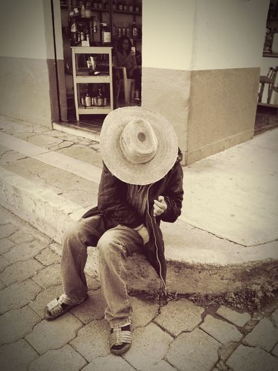 Mexico Jalisco Tequila Street Photography Man In Hat Man Wearing Sombrero Sombrero Sitting On Sidewalk Hot Day Midday Sun Western Mexican Hombre The Week On EyeEm