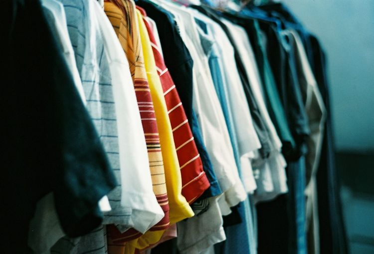 Close-up of clothes in row for sale at store