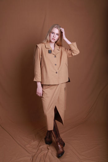 Studio photography, fashion model posing in stylish clothes for new collection catalog