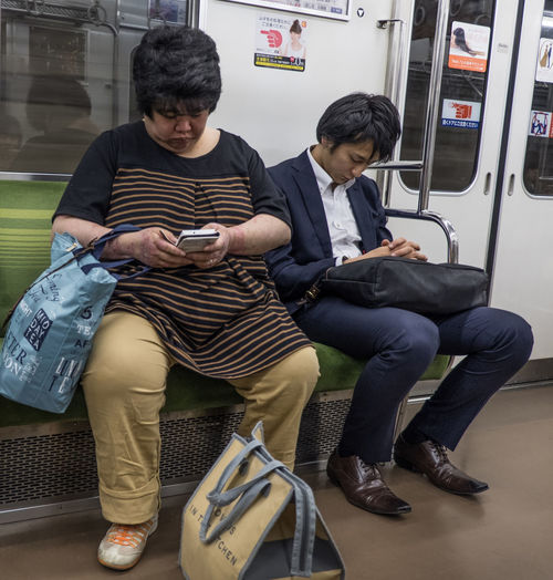 Scene of Tokyo's daily subway commuters, Tokyo, Japan Casual Clothing City Life Commuter Japan Passenger People Person Ride Scene Sleeps Subway Subway Station Texting Tokyo Train Transportation Travel Traveling