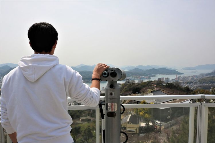 Onomichi Port and Seto Inland Sea from Senkoji Park Rear View Real People Coin Operated Architecture One Person Leisure Activity Men Mountain Standing Sky Binoculars Coin-operated Binoculars Nature Built Structure Waist Up Casual Clothing Lifestyles Building Exterior Technology Outdoors Looking At View Cityscape Onomichi Onomichi, Japan Onomichi Hiroshima Japan, Setouchi Sea Seto Inland Sea Mountain View Japan Senkoji Senkoji Park My Best Photo
