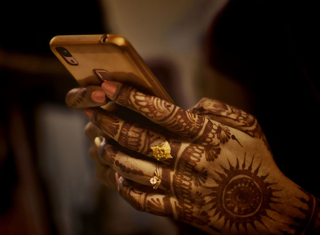 Wedding Close-up Communication Connection Day Engagement Ring Focus On Foreground Holding Human Body Part Human Hand Indoors  Lifestyles Mehendi Art Midsection Mobile Phone One Person Real People Ring Technology Wireless Technology Women