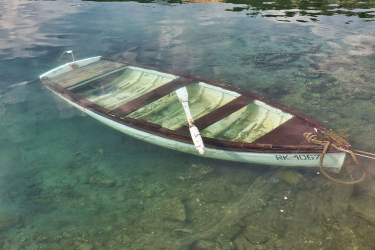 High angle view of abandoned ship moored in sea
