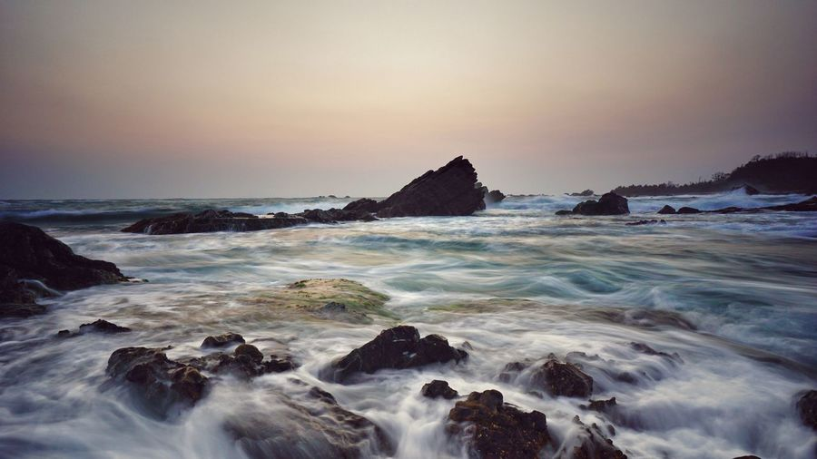 The Kàrang Bobos beach.. Beach Sunset Horizon Over Water Scenics Long Exposure Landscape Outdoors Clear Sky Sea Seascape Seaside Rock - Object Wave Travel Destinations No People Nature Breaking Sky Motion Water Beauty In Nature Power In Nature Landscape_Collection