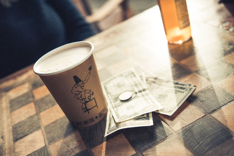 Coffee and change at Caffe Fiore in Ballard, Seattle. Cafe Caffe Fiore Caffè Change Chess Table Coffee Coffee And Change Coffee Break Coffee Cup Coffee Shop Coffee Time Dollar Dollar Bill Dollars Drink Latte Loose Change Money Morning Morning Coffee Morning Light Table Vintage