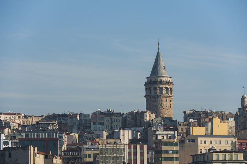 Galata tower in Istanbul Architecture Blue Building Exterior Built Structure City City Life Cityscape Cloud Cloud - Sky Day Dome Galata High Angle View Istanbul No People Outdoors Residential District Sky Tall - High Tower Travel Travel Destinations Traveling Turkey