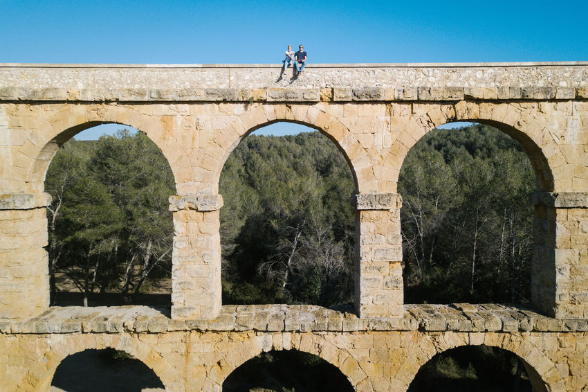 Aqueduct DJI X Eyeem Drone  The Ferreres Aqueduct Aerial Aerial View Ancient Arch Architecture Bridge Bridge - Man Made Structure Built Structure Clear Sky Day Dronephotography History Low Angle View Old Old Ruin Outdoors Real People Tree Press For Progress
