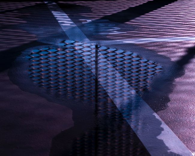 Freedom is a matter of perspective Bluehour Twilight Reflection Floor High Angle View Pattern Shadow Real People Street Capture Tomorrow
