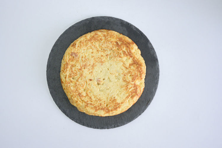 High angle view of bread in plate against white background
