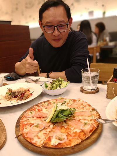 Man eating food in restaurant