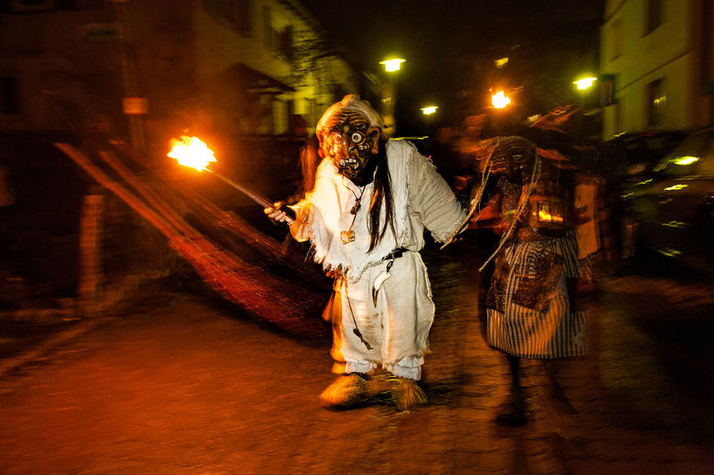 Adult Costumes Fasnacht Fasnet Fasnet ;* Fire Illuminated Night Occupation Outdoors People Swabian.Allemannic-Carnival Torches Tradition Tübingen Bühl Witch's Broom