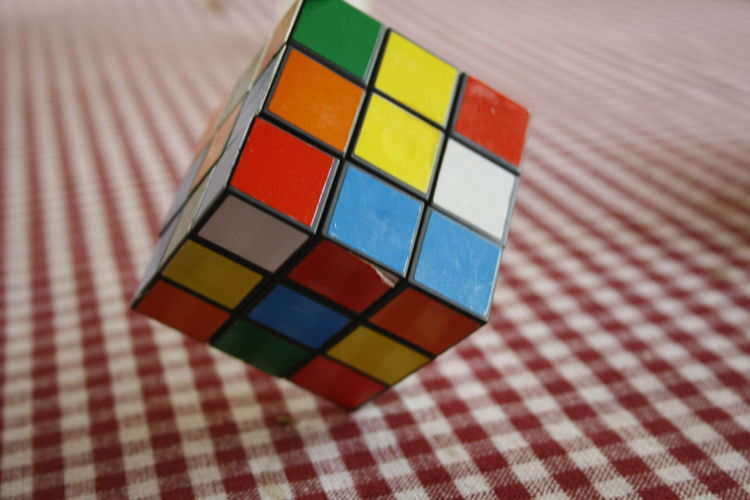 Multi colored puzzle cube on table