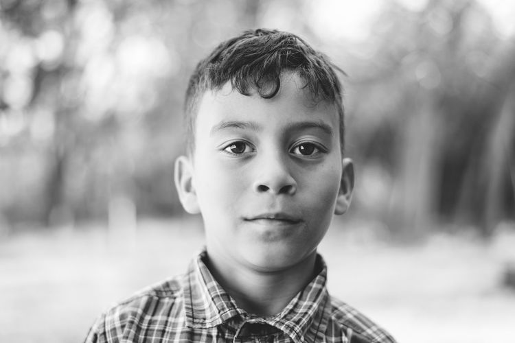 Boys Casual Clothing Childhood Close-up Cute Elementary Age Focus On Foreground Front View Headshot Innocence Leisure Activity Lifestyles Looking At Camera Person Portrait Smiling