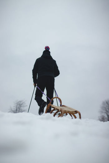 Rear view of man in snow