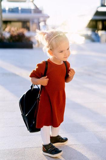 Full length of cute baby girl outdoors