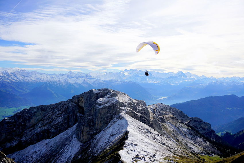 Lucerne Luzern Adventure Beauty In Nature Cloud - Sky Day Exhilaration Extreme Sports Flying Gliding Leisure Activity Lifestyles Luzern, Switzerland Mountain Mountain Range Nature One Person Outdoors Parachute Paragliding Pilatus Sky Sport Switzerland Unrecognizable Person
