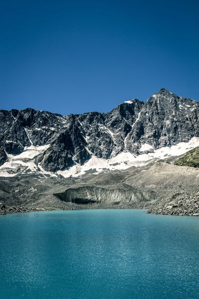 Glacier Lake @ Col d´Arsine Alpes Beauty In Nature Blue Clear Sky Cold Temperature Copy Space Day France Glacier Idyllic Lake Landscape Mountain Mountain Range Nature Scenics Season  Snow Tranquil Scene Tranquility Water Waterfront Winter Landscapes With WhiteWall