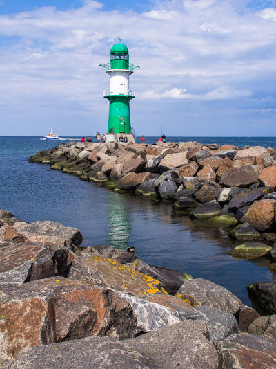 North Of Germany Olympus Rostock Rostock Warmemünde Tourist Attraction  Tourists Architecture Baltuc Sea Building Exterior Built Structure Cloud - Sky Day Direction Edithnerophotography Guidance Horizon Over Water Lighthouse Protection Rock - Object Safety Scenics Sea Sky Tourist Destination Water