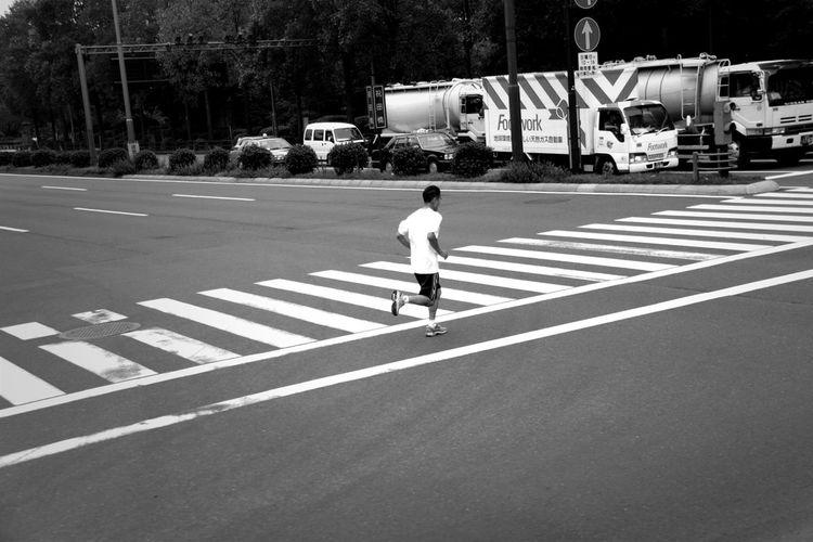 Jogger Running Across Street