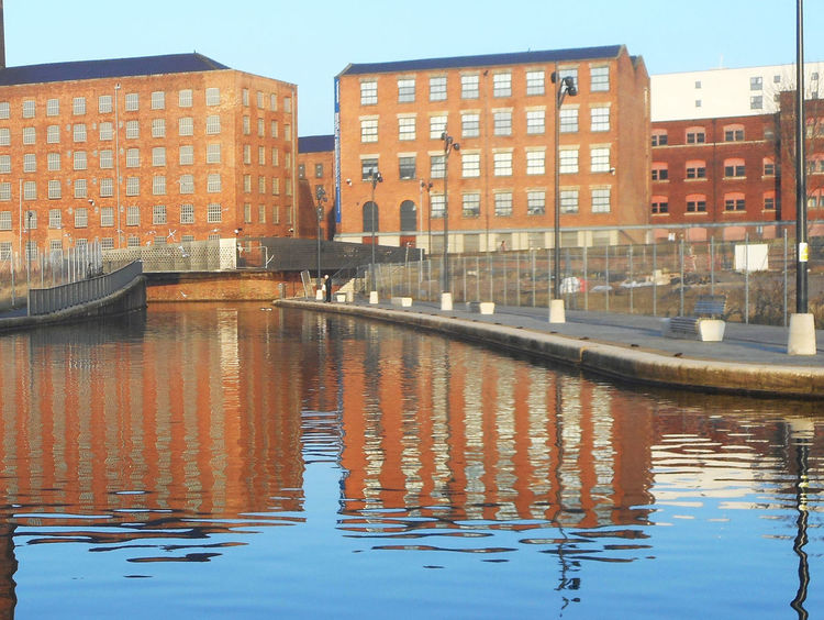 Manchester canal, UK. Architecture Building Exterior Built Structure Canal City Development Horizontal Symmetry Manchester Canal Mills Outdoors Reflection Water Waterfront