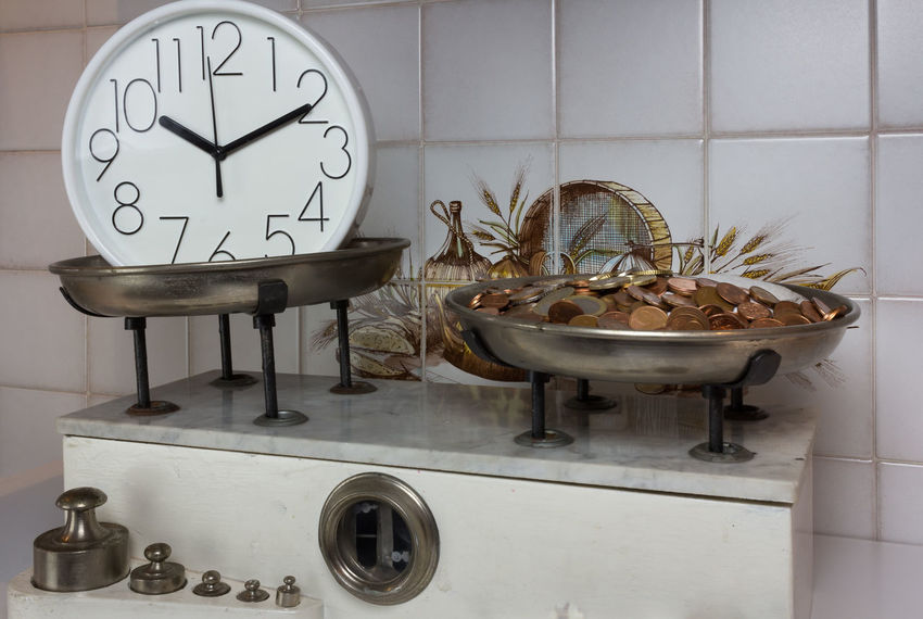 Balance with two metal plates with coins and clock Antique Balance Clock Diet Gram Imbalance Kilogram Measure, Measurement Metal Money Old Retro Time Vintage, Toy, Old Photo Weight